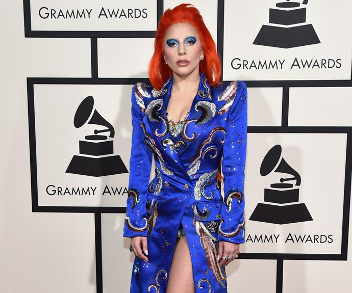 A flame-haired Lady Gaga turned heads on the red carpet before taking to the stage to perform a tribute to the late David Bowie.