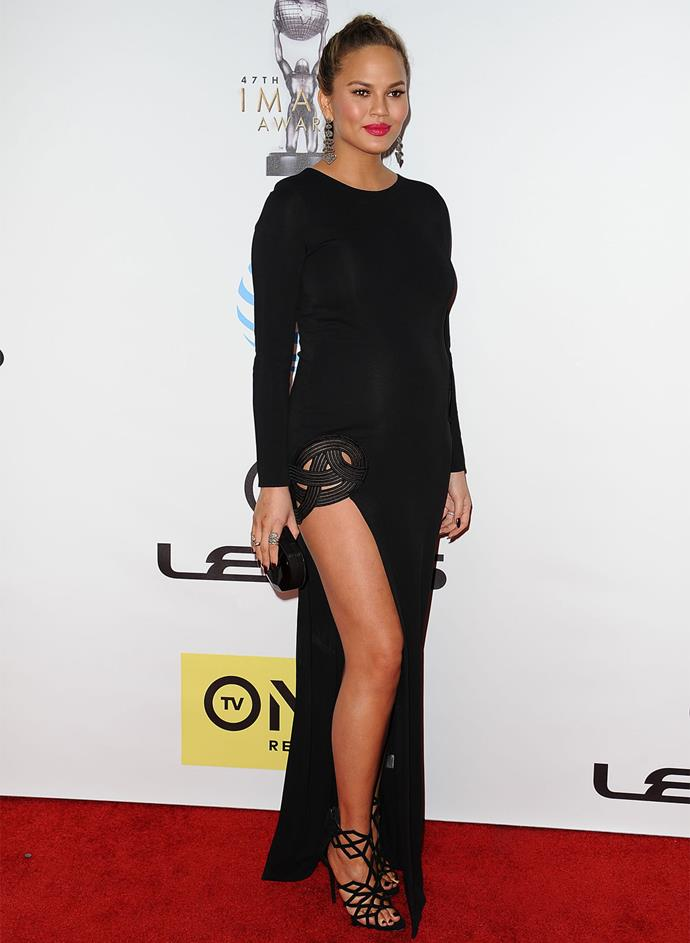 **February 5, 2016:** The model paired a long-sleeved black gown (with a super sexy thigh-high slit) with hot pink lips and statement earrings for a glam look on the red carpet at the NAACP Image Awards.