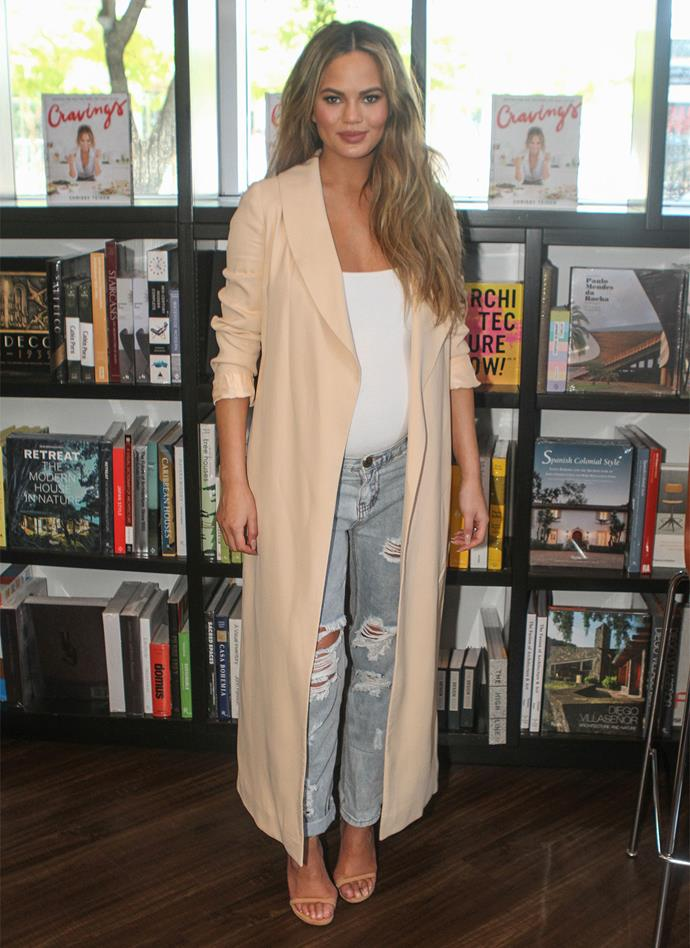 **February 26, 2016:** At a signing for her cookbook *Cravings*, Chrissy dressed down in relaxed denim and a long line blazer.