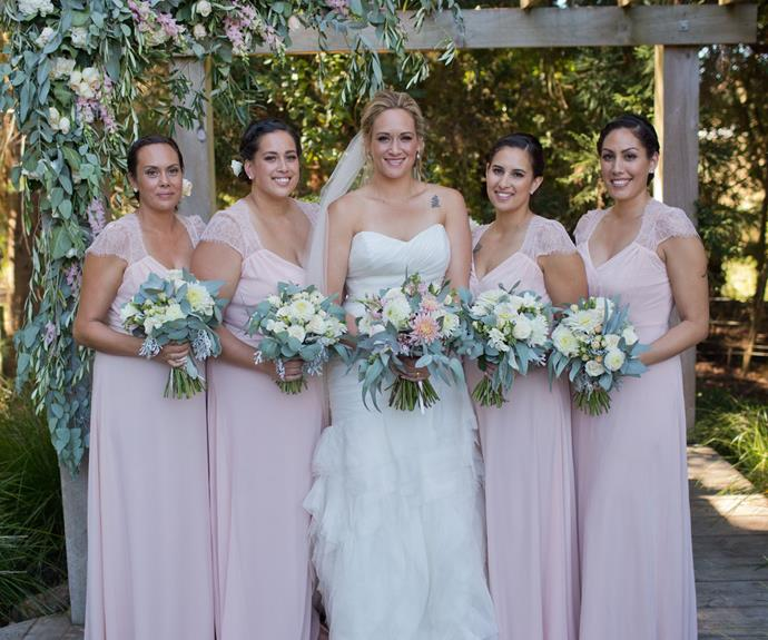 The gorgeous bride cosies up to her bridesmaids.