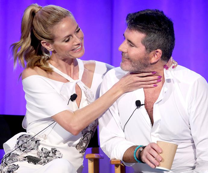 Heidi Klum and Simon Cowell get playful at America's Got Talent event. Photo: Getty