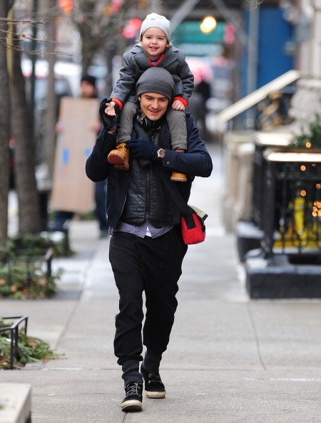 Flynn Bloom takes a ride on proud dad Orlando's shoulders as the pair take a stroll through the city streets.