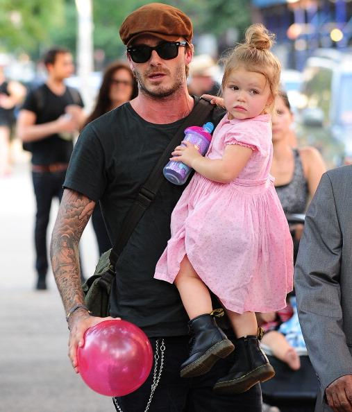 Harper's pretty in pink as she holds on tight to her dad.
