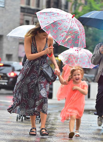 Jessica Alba keeps a tight grip on daughter Haven Warren's hands as they brave the rain on a day out.