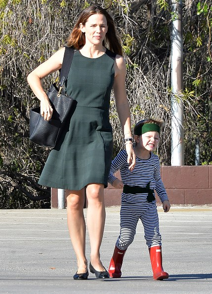 Jennifer Garner and Ben Affleck's son Samuel looks totally adorable in his matching striped top and pants and bright red gumboots.