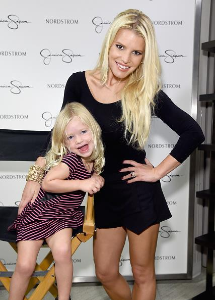 Jessica Simpson and her daughter Maxwell Drew strike a pose for the cameras.