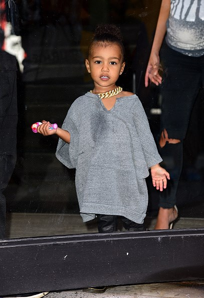 North West serves plenty of attitude in this adorable grey ensemble.