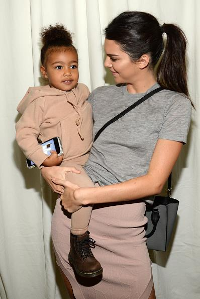 North rocks the tomboy look in a camel-coloured hoodie and leggings.