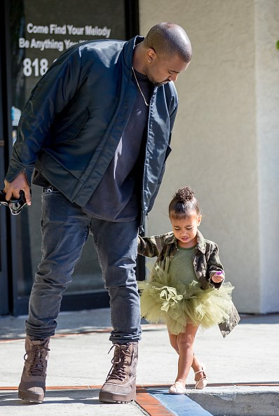 North looks adorable in her green ballet tutu and matching camouflage-patterned jacket.