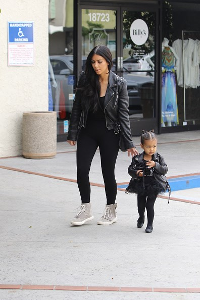 Matching yet again! Kim and North don almost identical leather jackets.