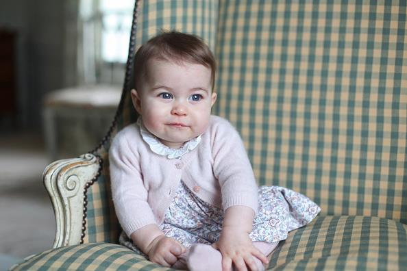 In this sweet photo taken by Duchess Catherine herself, Princess Charlotte is adorable in a patterned dress and pink cardigan.