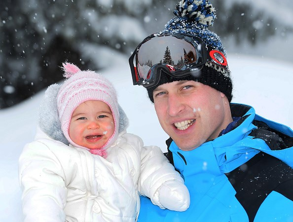 The little Princess is adorably rosy-cheeked in her snow gear during a family holiday.