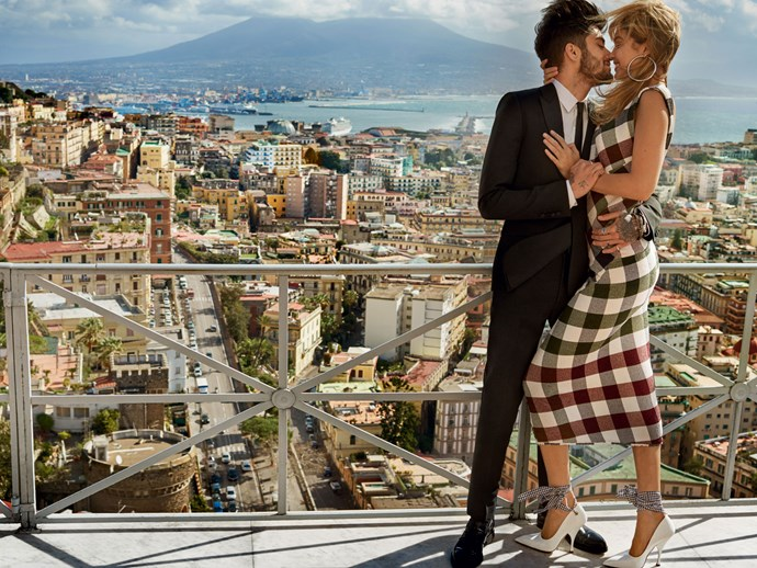 The couple steal a kiss in front of a picturesque backdrop in Naples, Italy. Photo: Mario Testino/Vogue