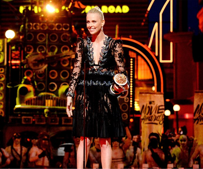 Charlize Theron takes to the stage to accept the award for Best Female Performance for her role as Imperator Furiosa in *Mad Max: Fury Road*.