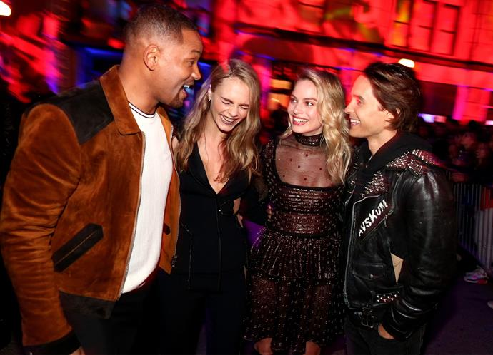 Will Smith shares a laugh with his *Suicide Squad* co-stars Cara Delevingne, Margot Robbie and Jared Leto.