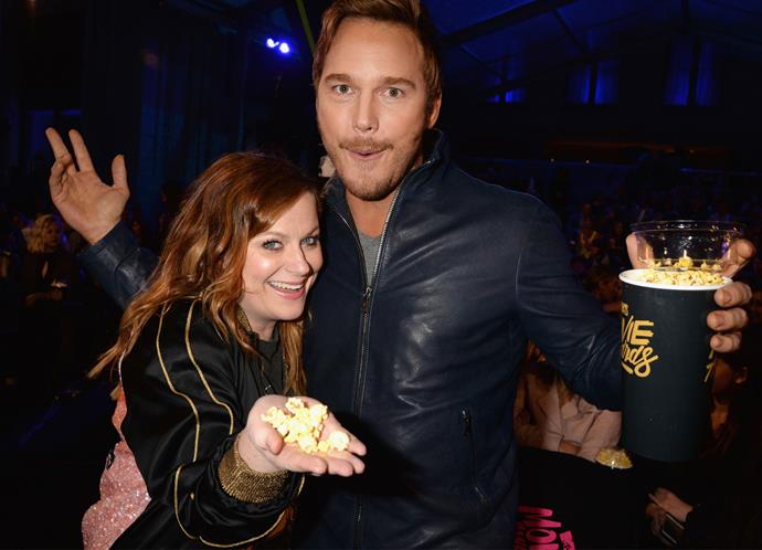 Former *Parks and Recreation* co-stars Amy Poehler and Chris Pratt get cosy at the awards.