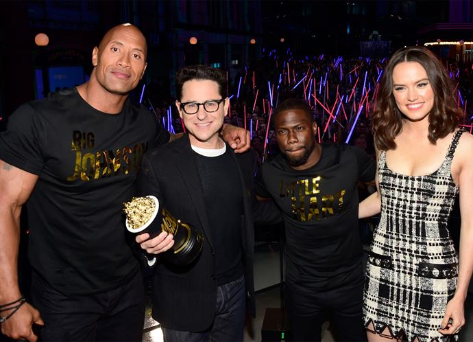 The Rock, director JJ Abrams, Kevin Hart and Daisy Ridley pose for a photo.