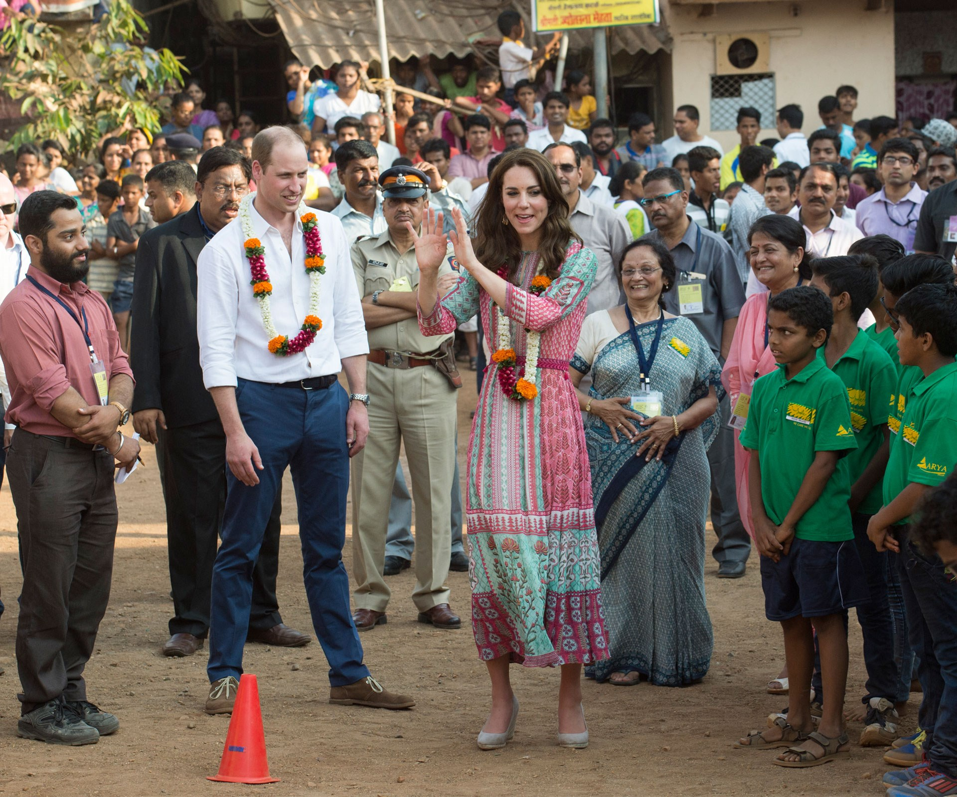 April 2016: The couple have fun with locals during their tour of India.