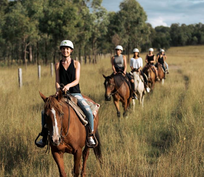 The Bachelorettes trek through the countryside on horseback during a group date.