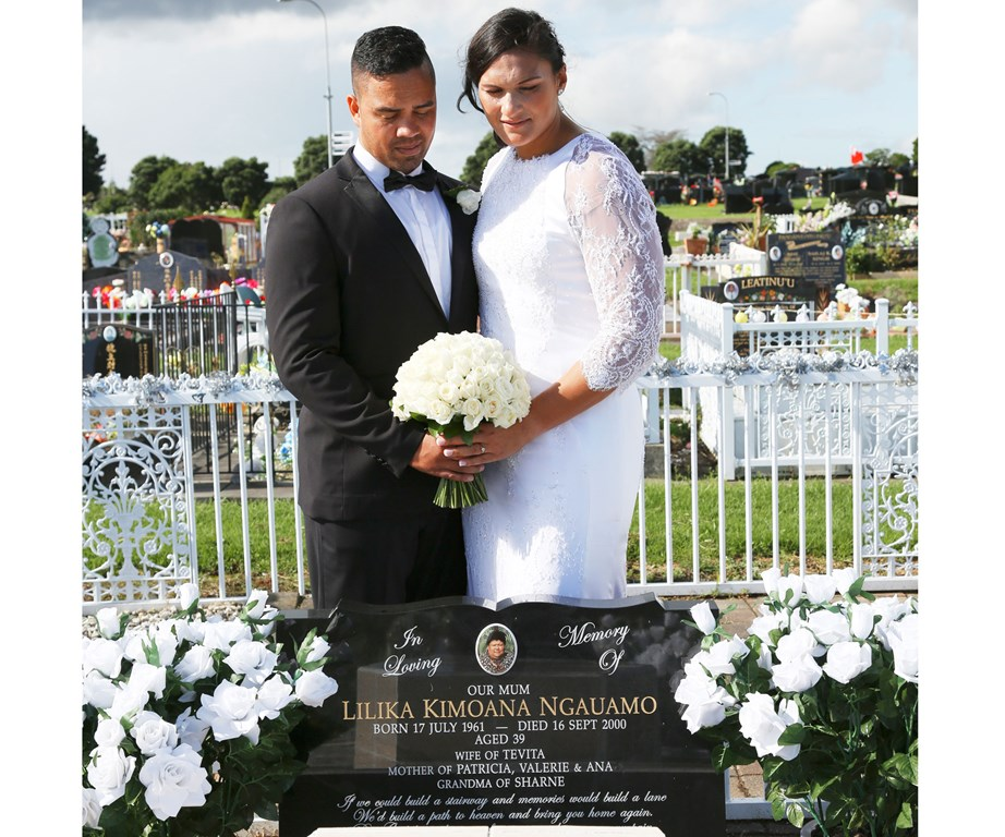 Valerie and her husband at her mum's graveside on their wedding day. Valerie's mum passed away when she was just a teenager.