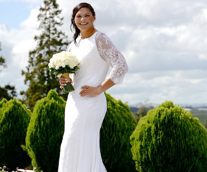 Valerie's wedding dress was custom-made by Auckland designer John Zimmermann, who created a sleek, figure-hugging silk-satin number with French-knotted, sequined Chantilly lace panels.