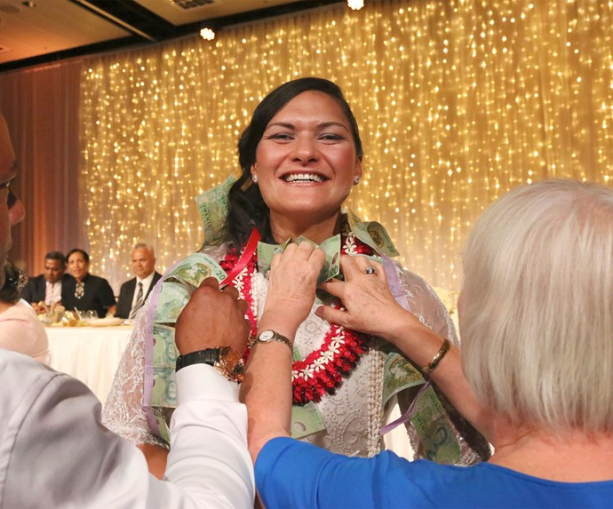 In keeping with Tongan tradition, guests shower the couple with money for their families.