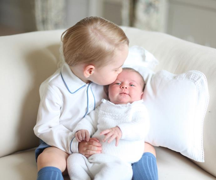So sweet! Prince George gives his sister a little kiss. Photo: Getty