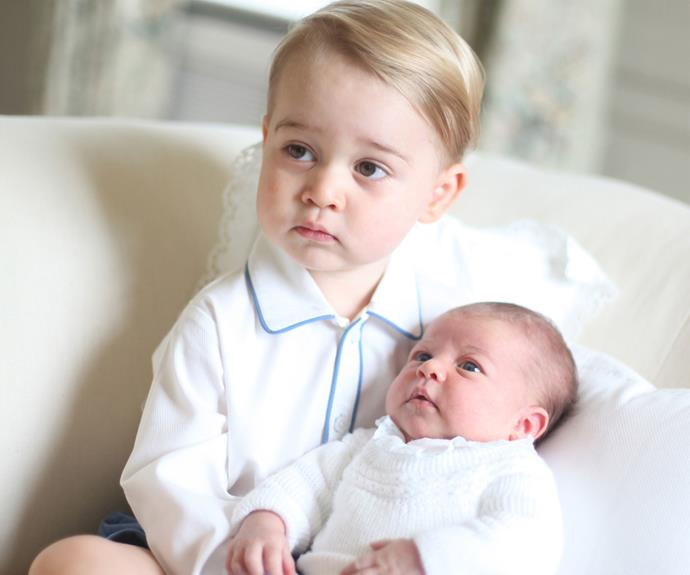The Duke and Duchess of Cambridge released adorable images of Prince George holding his little sister, Princess Charlotte. Photo: Getty