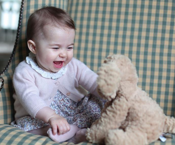 Proud mother Kate released this cute image she took of Charlotte playing with her teddy. Photo: Getty