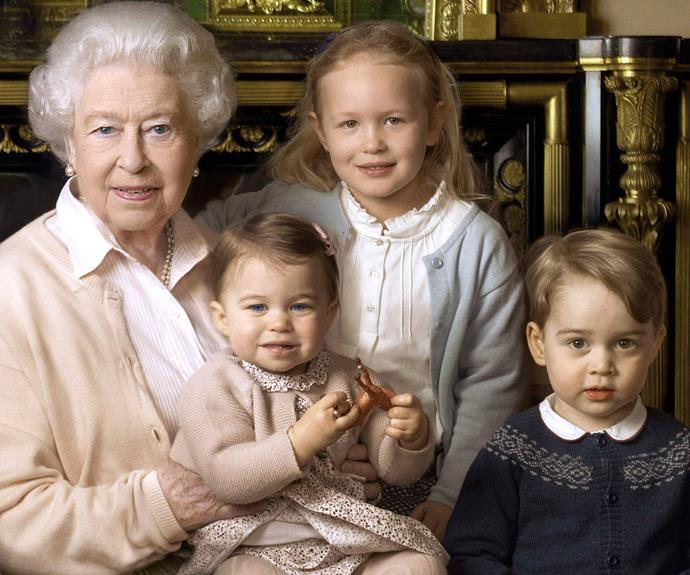 Princess Charlotte sits on the Queen's knee in this gorgeous family photo released to celebrate the Queen turning 90. Photo: Annie Leibovitz