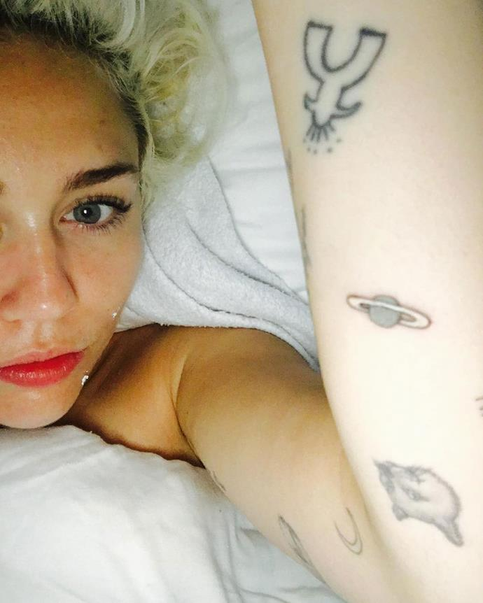 Miley Cyrus shows off her new tattoo of the planet Saturn - which she originally mistakenly identified as Jupiter - on Instagram.