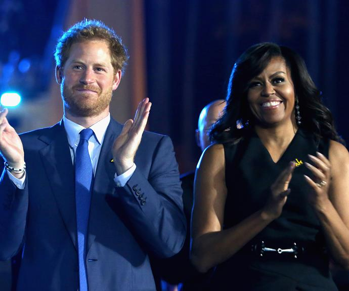 Prince Harry at the opening ceremony with US First Lady Michelle Obama. Photo: Getty