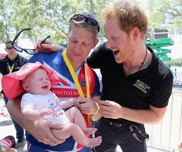 Rob Cromey-Hawke ( the British double gold winner in recumbent cycling) and his daughter Pippa meet Prince Harry at the road cycling event during the Invictus Games. Photo: Getty