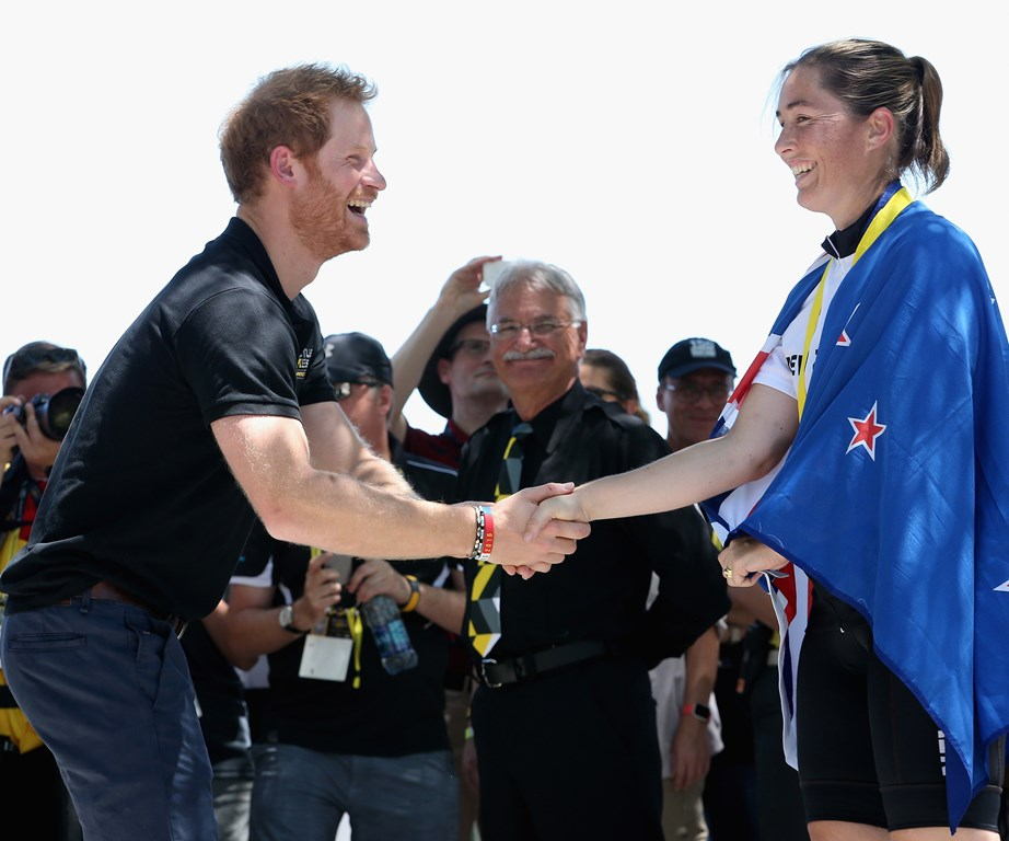 The royal congratulates New Zealander Amy Baynes as she is awarded the silver medal in road cycling at the 2016 Invictus games