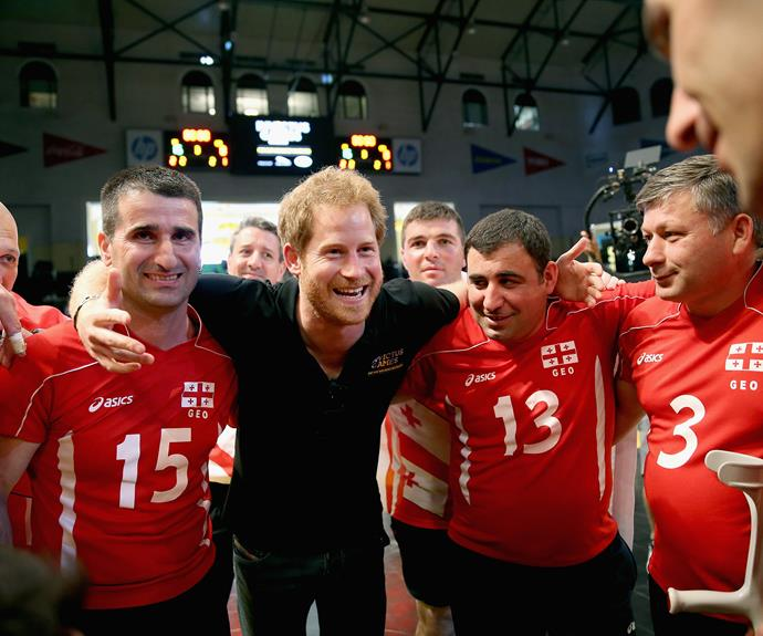Harry huddles with the Georgia team after they were beaten by the UK Armed Forces Team at sitting volleyball. Photo: Getty