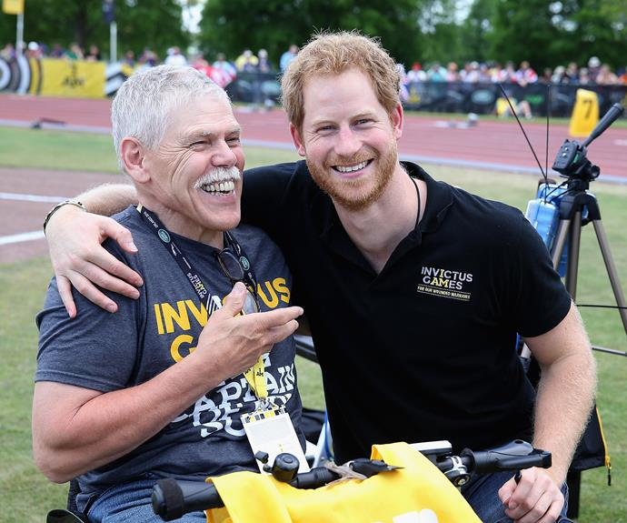 Prince Harry meets a photographer in a wheelchair during the Invictus Games. Photo: Getty