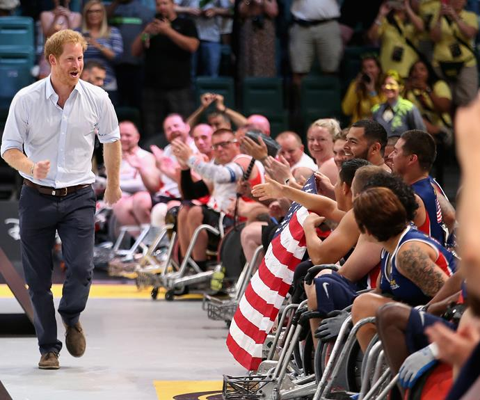 Harry presents medals to the USA Wheelchair Rugby team after they beat Denmark in the wheelchair rugby finals at the Invictus Games. Photo: Getty