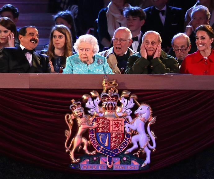 The Queen, Prince Philip, Duchess Catherine and other royals look on as performers put on displays for the Queen's birthday. Photo: Getty