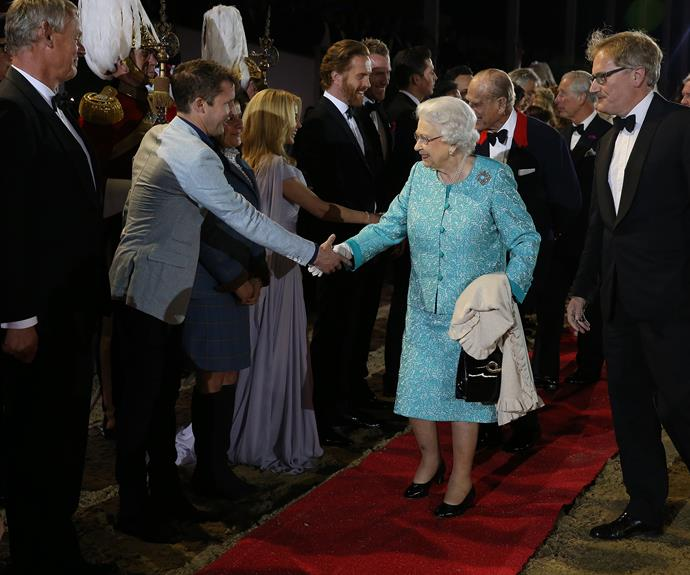 The Queen greets guests at the final night of her birthday celebrations at Windsor Castle. Photo: Getty