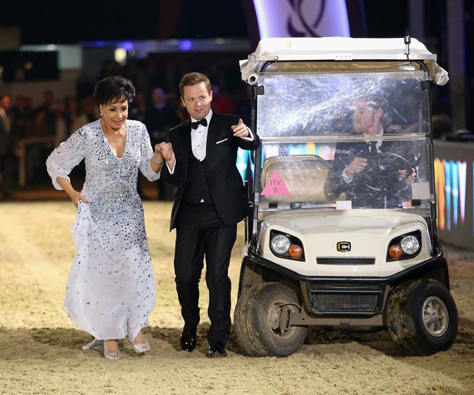 Dame Shirley Bassey is escorted through the venue by host Declan Donnelly.