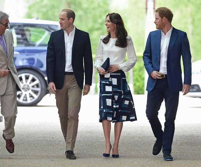 Prince William, Duchess Catherine and Prince Harry share a laugh as they walk into the venue. Photo: Getty