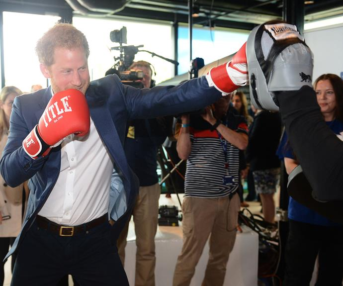 The royal also tried his hand at boxing, throwing a few punches with world champion boxer Duke McKenzie. Photo: Getty