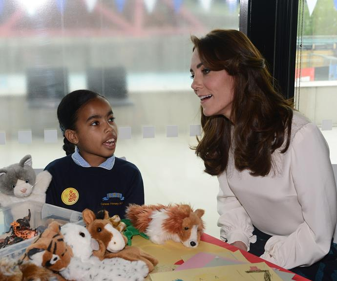 Kate plays with nine-year-old Eliana Bayan at the launch. Photo: Getty