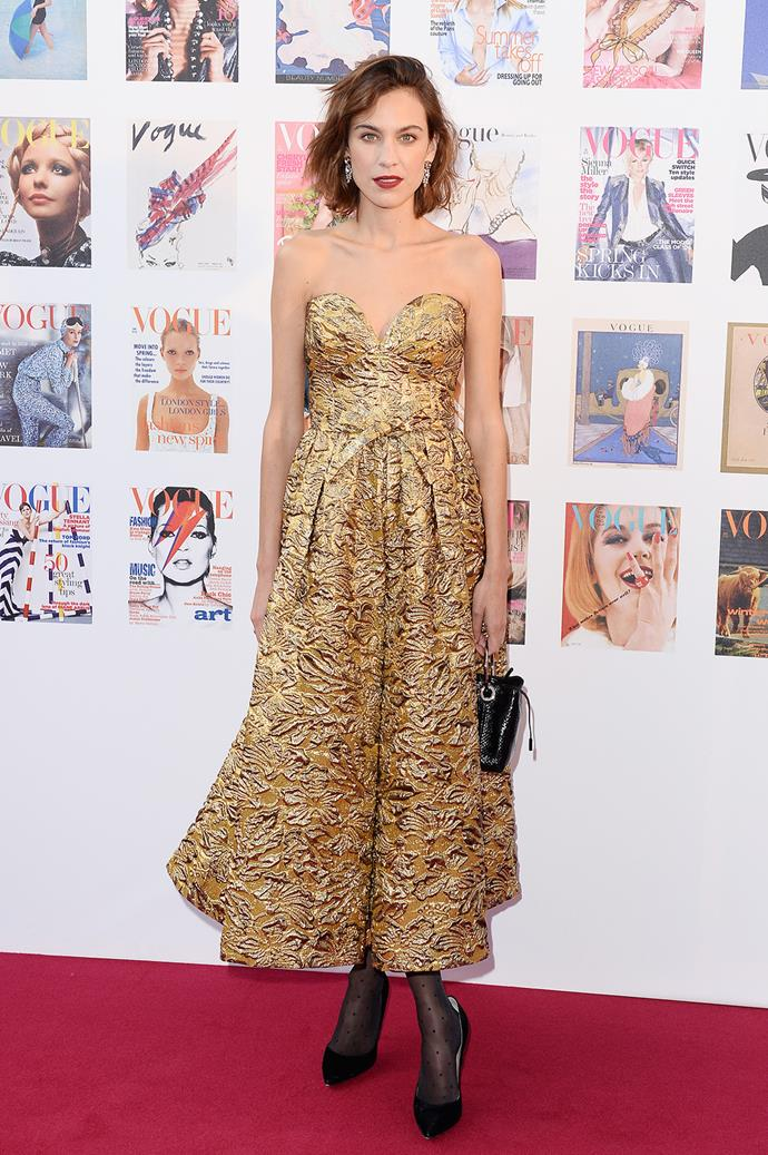Golden girl! Alexa Chung wowed as she hit the red carpet.