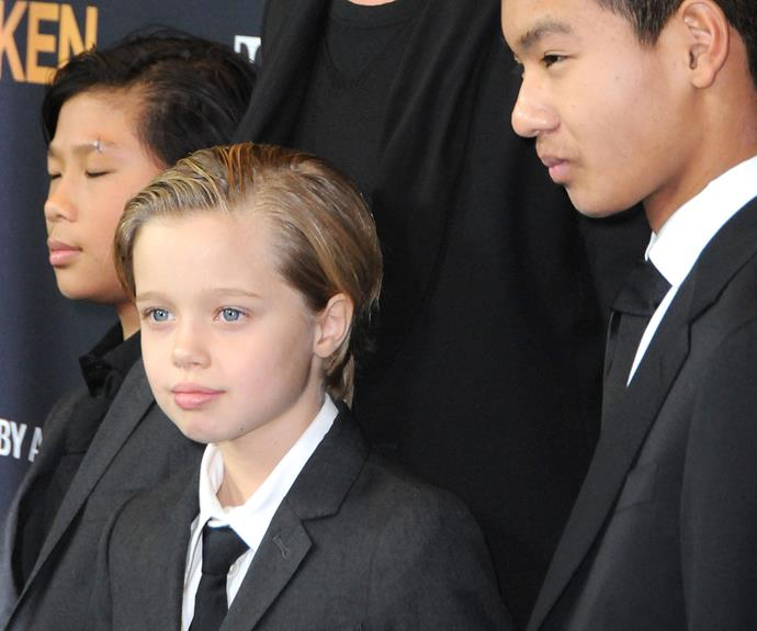 Shiloh attends the premiere of *Unbroken* (directed by her mum!) with her brothers Pax and Maddox in 2015.