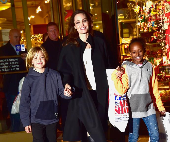 Again, four years later, Zahara and Shiloh join mum for the Christmas shopping at the very same shop as before, this time in November, 2014. Shiloh and Zahara look so much more grown up!
