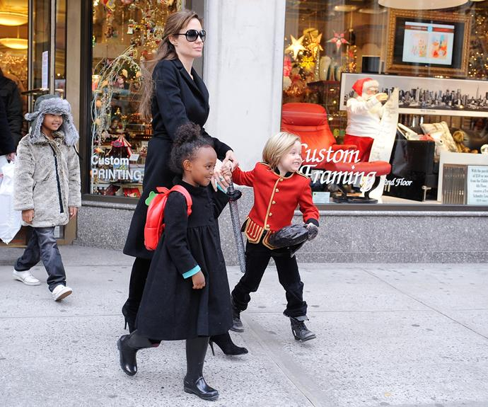 Shiloh (aged four years old at the time) could hardly contain her excitement as she, Maddox, Zahara and Angelina did their Christmas shopping in New York City in December, 2010.