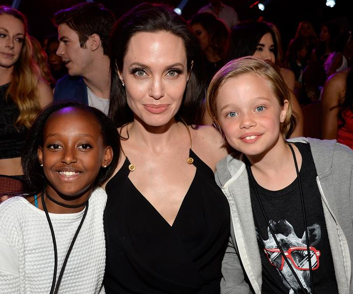 "Shiloh Nouvel Jolie-Pitt with her sister, Zahara, and her mother, Angelina, in the audience at the Nickelodeon's 28th Annual Kids' Choice Awards where Angelina won the award for ""Best Villain"" in March, 2015."