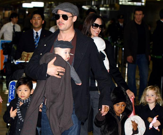 The whole Jolie-Pitt clan, (dad Brad, mum Angelina and their children Pax, Knox, Vivienne, Zahara and of course the then-two-year-old Shiloh) arrive at the airport in Japan in 2009. Brad was on a promotional tour for his film *The Curious Case Of Benjamin Button*.
