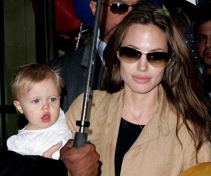 Angelina cradles a one-year-old Shiloh as she steps out in New York in 2007 - even then she had her mum's looks!
